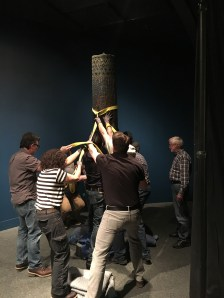 The column is moved into its home and secured into place.